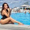 FOTO. Gimnasta Larisa Iordache nu se mai ferește! Fosta gimnastă și-a găsit fericirea în brațele unui tânăr musculos